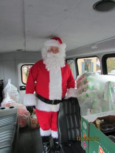 Santa in the On The Town Limousines, Ambassador Bus