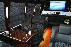 Interior Congressional Bus with gold lighting